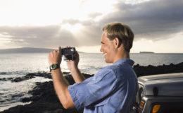 Man Using Video Camera at the Beach